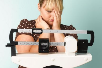 woman-on-scales-sad-2682769
